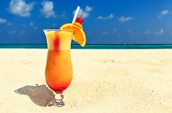 Glass of cocktail is on sandy coral  beach Stock Images