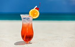 Glass of cocktail is on sandy coral  beach Stock Image