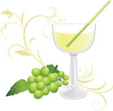 Glass with cocktail and sprig of green grape Stock Photos