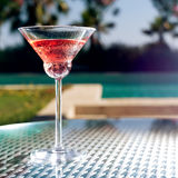 Glass of cocktail. On the glass table in outdoor resort bar Stock Photo