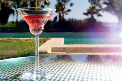 Glass of cocktail. On the glass table in outdoor resort bar Stock Photos