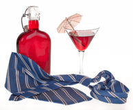Glass of cocktails. Necktie and bottle on white Royalty Free Stock Photos