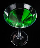Glass of cocktails. Glass of green cocktails on black background Royalty Free Stock Images