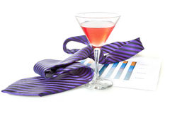 Glass of cocktails. Necktie and document (chart Stock Images