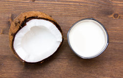 Glass with coconut milk on wood from above Stock Image