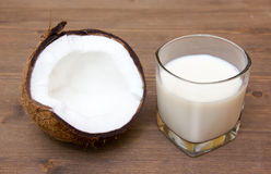Glass with coconut milk on wood Royalty Free Stock Photos