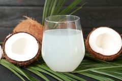 Glass of coconut water. On table royalty free stock photography
