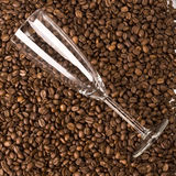 Glass on coffee Royalty Free Stock Image