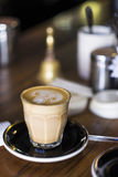 Glass of coffee on cafe counter Stock Photo