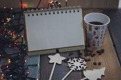 Notepad, a glass with snowman print and decorations on a tablen Stock Photography