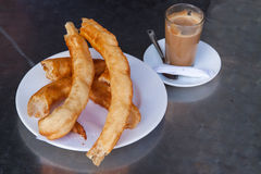 Glass of coffee with churros Royalty Free Stock Image