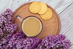 Glass coffee Cup with cookies and milk on a background of purple lilac Stock Photo