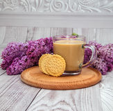 Glass coffee Cup with cookies and milk on a background of purple lilac Stock Photos
