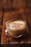Glass coffee cup on rustic textured wooden table Stock Images