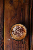 Glass coffee cup on rustic textured wooden table Stock Photo