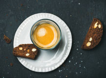 Glass of coffee espresso with chocolate and sea salt biscottii Royalty Free Stock Photo