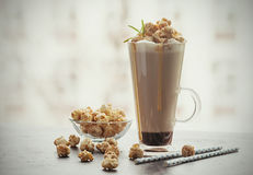 Glass of coffee with popcorn royalty free stock photography