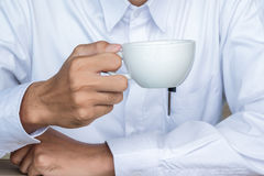 Glass coffee in men`s  hands Royalty Free Stock Images
