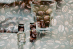 Glass of coffee for taster to smell and taste aromatic and flavo. R wheel. art of aroma perception in brewed coffee double exposure with roasted bean. cupping Royalty Free Stock Images