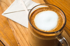 Glass of coffee. On the wooden table stock photography