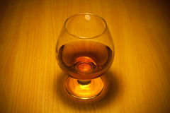 Glass of cognac Stock Images