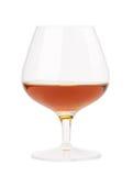 The glass of cognac Stock Photos