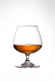 Glass of Cognac. Snifter glass of cognac on white background Stock Photography
