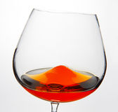 Glass of Cognac. Cognac Snifter glass with liquid inside Royalty Free Stock Photography