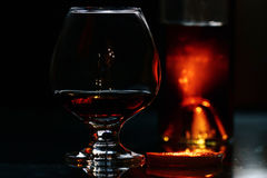 Glass of cognac on black background Royalty Free Stock Image