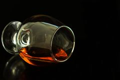 Glass of cognac on a black background. Copy space stock photo