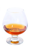 Glass of Cognac or Brandy. Snifter glass of cognac isolated on white Royalty Free Stock Photography