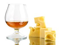 Glass of cognac and cheese Stock Photo