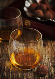 Glass of cognac and chocolate truffles Stock Photography