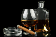 Glass of cognac with cigar Stock Images