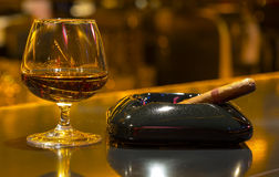 Glass of cognac and cigar Royalty Free Stock Images