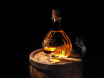 Glass of Cognac , Cigar and old oak barrel Stock Photography