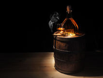 Glass of Cognac , Cigar and old oak barrel Royalty Free Stock Photo