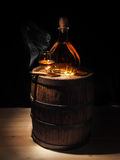 Glass of Cognac , Cigar and old oak barrel Royalty Free Stock Image