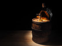 Glass of Cognac , Cigar and old oak barrel Stock Images