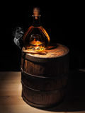 Glass of Cognac , Cigar and old oak barrel Royalty Free Stock Images