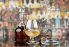 Glass of cognac with cigar Royalty Free Stock Photo