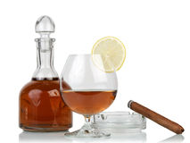 Glass of cognac with cigar Royalty Free Stock Photos