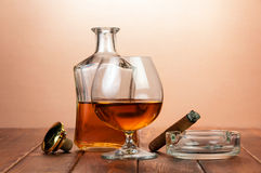 Glass of cognac with cigar Royalty Free Stock Images