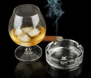 Glass of cognac with cigar Royalty Free Stock Image
