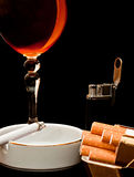 Glass of cognac and cigarette Stock Photography