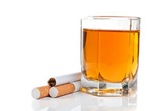 Glass of cognac and cigarettes Stock Photography