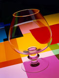 Glass of cognac with colors Royalty Free Stock Photography