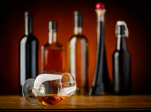 Glass of cognac and drinks Royalty Free Stock Photo