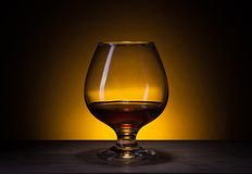 Glass with cognac Royalty Free Stock Image