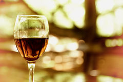 Glass with cognac glare in sunlight Royalty Free Stock Image